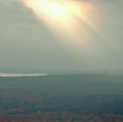 T-Berg Shining, the sun breaks through over Grunewald and illuminates Wannsee and Grunewaldturm
