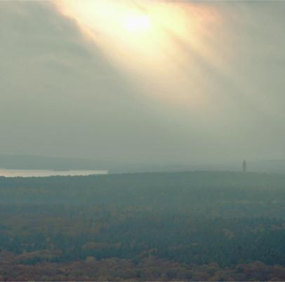 T-Berg Shining, the sun breaks through over Grunewald and illuminates Wannsee and Grunewaldturm