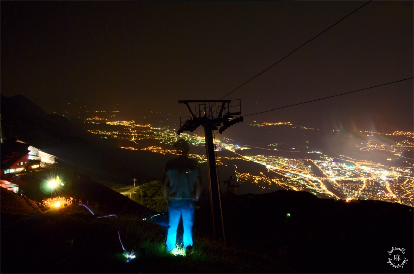 Overlooking the festivities of the Nordkette Wetterleuchten Eletronic Music Festival over Innsbruck, Austria